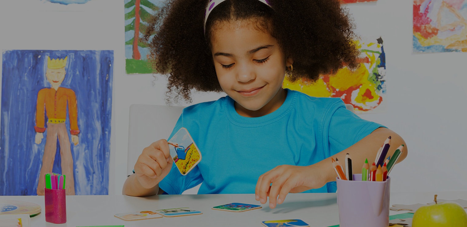 young girl playing with cards