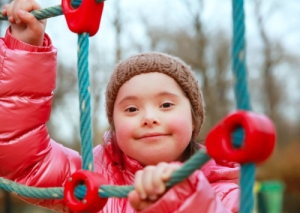 smiling child climbing on the rope